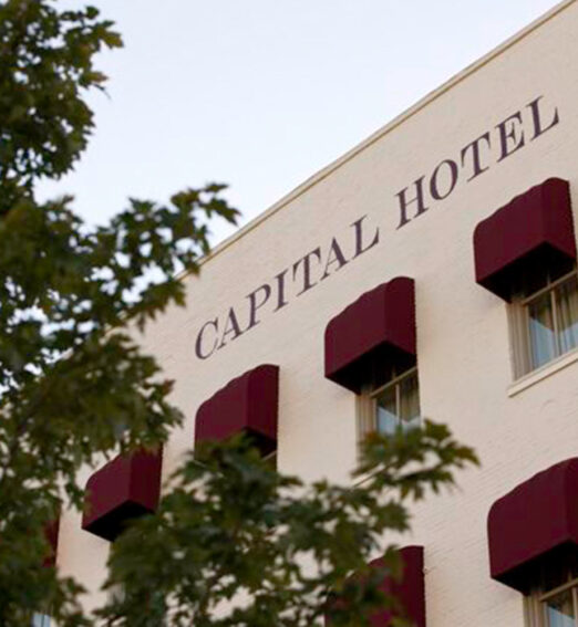 closeup of the capital hotel logo on the building