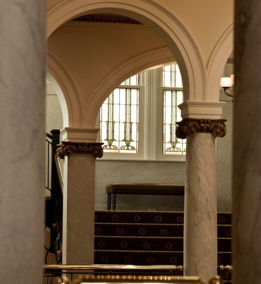 closeup of large arches and columns in a hotel lobby