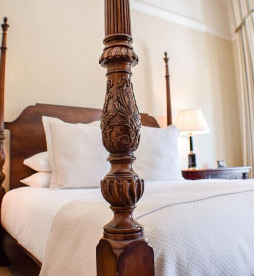 closeup of a carved wooden bed post