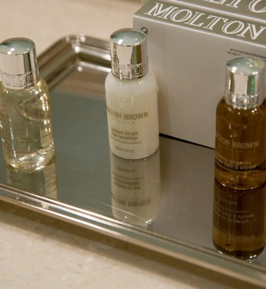 closeup of small soap bottles on a silver tray
