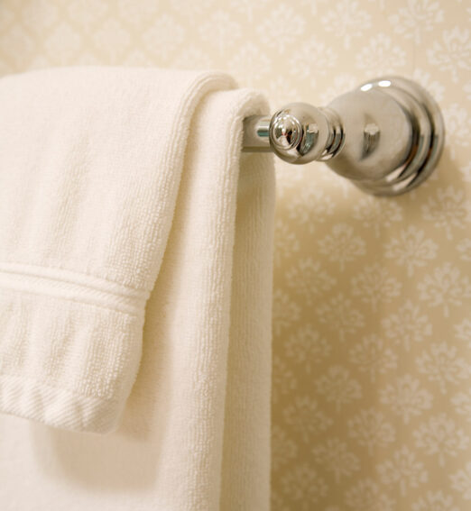 closeup of a towel on a silver towel rack