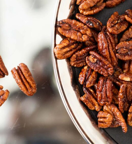 candied pecans in a clear bowl
