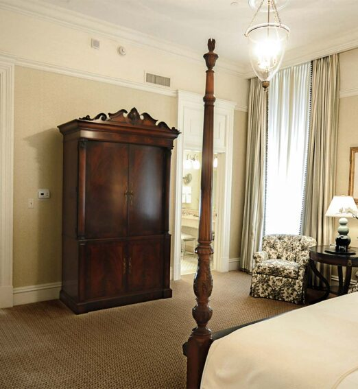 large hotel suite with a separate bathroom, seating room, and bedroom areas