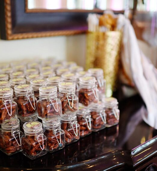 meeting venue with a brown cabinet displaying small jars of candied pecans